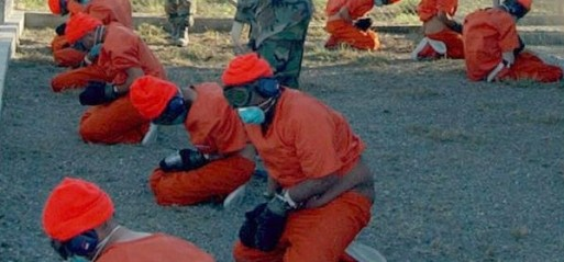 US-Camp_x-ray_detainees-Guantanamo-Bay-Jan-11-2002-Phot-Shane-T-McCoy-US-Navy-Creative-Commons-513x239[1]
